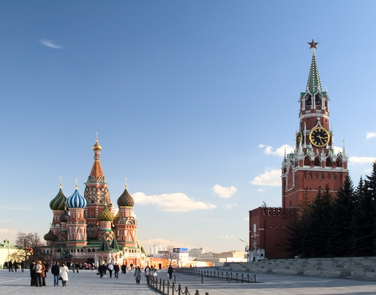 Picture: View on Saint Basil's Cathedral and Spasskaya Tower, known as 'Saviour Tower', from the Red Square along the eastern wall of the Moscow Kremlin.