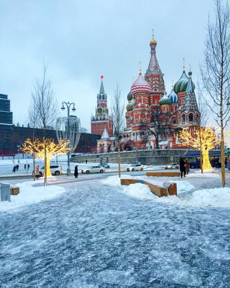 Picture: Winter view on Saint Basil's Cathedral and 'Saviour Tower', from Zaradye Park in Moscow.